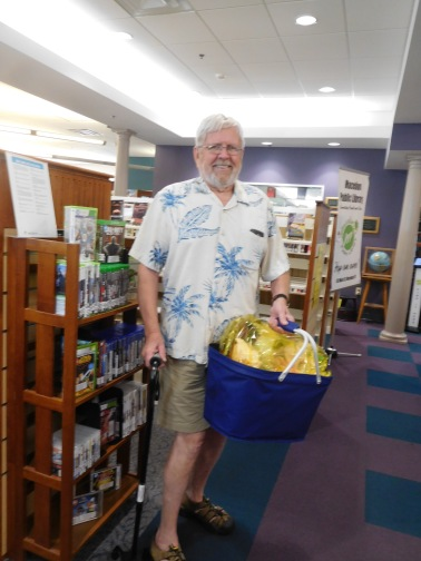 John Hamilton with the Summer Reading Basket he won