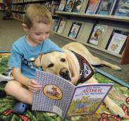 child.reading.to.dog